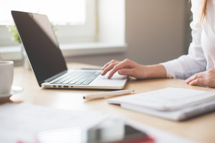 business-woman-working-on-laptop-in-her-office-picjumbo-com